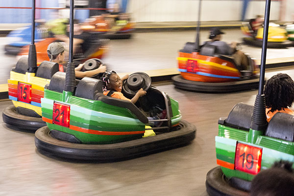 Five-year-old Taleeia races around the bumper car track.